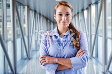 stock-photo-21850405-young-hispanic-businesswoman-in-bright-corridor