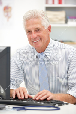 stock-photo-24615395-senior-doctor-at-desk